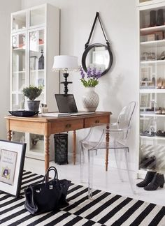 This is a great concept for your place… Place your table against the wall on it's short end.  Have a lamp on that end with art or a mirror or something on the wall above.  Place shelving units on either side for storage and display and books.  Add a rug if you like.  It would be a GREAT use of space.