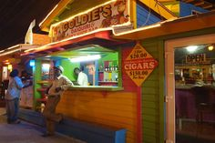 Soaking in the decidedly local scene at Goldie's Daiquiri & Sky Juice Bar at Arawak Cay Fish Fry in Nassau. For more on this famed Bahamas attraction, click here.