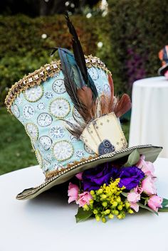 A quirky Mad Hatter floral centerpiece suitable for a tea party at Disneyland's Rose Court Garden