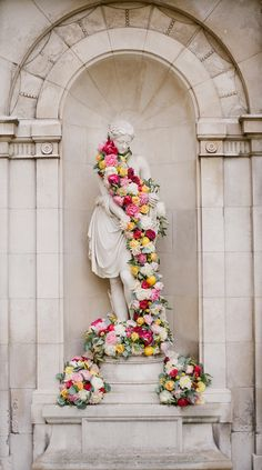 Great idea for an outdoor wedding...or for a statue located directly outside of the ceremony or reception venue