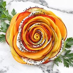 Fruit Salad Rose  made of mango, kiwifruit, red plum, strawberry, apricot and dragon fruit by @secretsquirrelfood enjoy! #letscookvegan