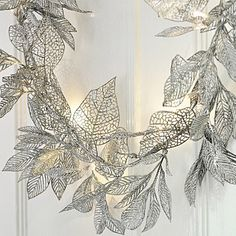 A gorgeous fairy light garland packed full of pretty silver leaves. Mains operated but with the option to plug in a battery adaptor. http://www.primroseandplum.co.uk/product.php/664/fairy-lights-silver-leaf-garland