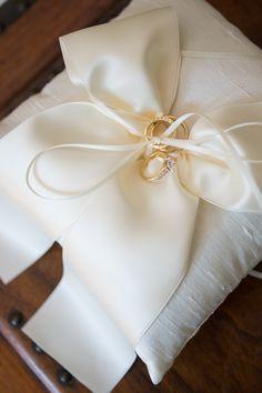 Classic White Ring Pillow -- See the wedding: http://www.StyleMePretty.com/2014/06/04/classic-new-england-beach-club-wedding/ Photography: CarlaTenEyck.com