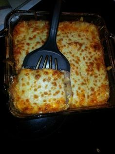 """CREAMY CHEESY CHILI POTATO CASSEROLE 2 medium potatoes, peeled and sliced 1/8 """",thick 3 cups of your favorite chili 1 (8 ounce) package cream cheese, cubed 1 can cream of mushroom soup 3 cups sharp cheddar cheese salt and pepper"""