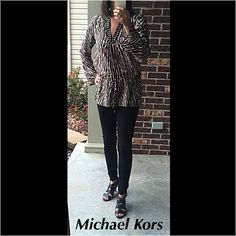 Michael Kors top Michael Kors print top. The sleeves flare a little. Bronze studs around neck opening. Drawstring around waist and can since it as needed. Very comfortable. 100% polyester Michael Kors Tops