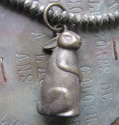Brass Bunny  Old baby rattle from England is on a rope of gorgeous pyrite beads.  The bunny has a soft jingle.