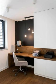 a home office nook is visually separated from the . a home office nook is visually separated from the rest of the space with a black statement wall –