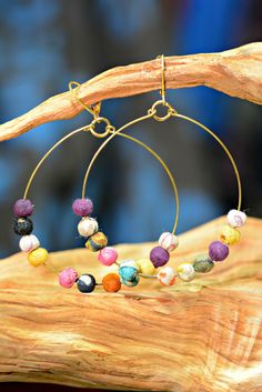 Reclaimed Sari Hoop Earrings Our Fair Trade Reclaimed Sari Hoop Earrings are a departure from your typical hoop earrings. Brass hoops feature multicolored beads made out of recycled sari fabric. Each pair of earrings is completely unique and each pair is stunning.  #fairtrade #earrings #recycled #ethcialfashion