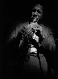 """""""Coltrane on Soprano, 1963"""", captures the performer in his musical element. Coltrane was one of photographer Roy DeCarava's favorite subjects. """"I traveled up and down the East Coast to hear him play and to photograph him. I shot photos in the clubs with the lighting that was available. If I thought I was bothering him, then I wouldn't shoot. I would just listen to the music."""""""