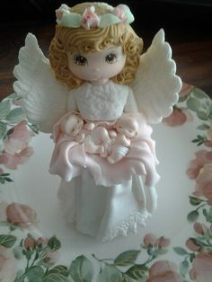 Our twin daughter's baptism.  Angel cake topper holding twins.