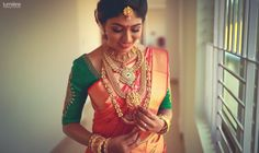Shopzters   15 Brides Who Proved Green Is Still The Most Preferred Blouse Color For The Red Saree