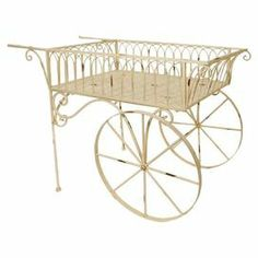 "Distressed iron garden cart.   Product: Garden cartConstruction Material: Iron Color: Distressed ivoryDimensions: 32"" H x 48.5"" W x 22"" DNote: Assembly required"
