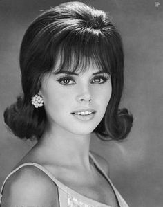Pretty in the 60's   We all had to wear out hair like this curled up on the ends and we thought we were so with the style and it is pretty yet today. J. Poppen