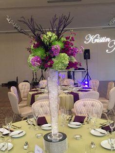 A tall floral design of Green Hydrangea, Green Fuji Mums, Purple Stock, and Eggplant Purple Grevillia sprays in a Trumpet vase! #ashtongardensatlanta, #ashtongardens, #awsfloraldesign