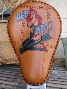 "Nose art/Pin-up girl ""Red Hot"" custom hand tooled leather motorcycle seat. $450,00, via Etsy."