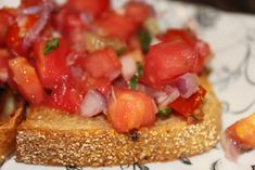 Tomato Bruschetta - No Oil - 2 large red tomatoes, or 3 small tomatoes, chopped into 1/4-inch cubes  1/4 large red onion (or 1/2 medium/small red onion), diced  2 cloves of garlic, minced  6 fresh basil leaves, chopped or torn  SALT and white pepper  1 loaf of high-quality Italian bread, sliced into 1/4-1/2-inch slices <---- sub MELBA TOAST --- cooking spray  optional: olive oil for drizzling (No Seasoning)
