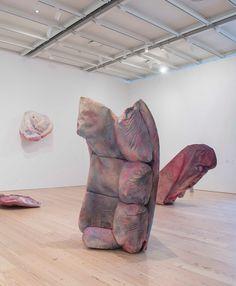 Kaari Upson, installation view of Supplement II, 2016. Abstract pink sculptures hanging in a corner