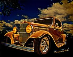 """My favorite time of the day – especially for making photos of cars or people for that matter – has to be """"The Golden Hour"""".  That's the hour right around sunrise or sunset when there's lots of nice warm light at a low incident angle – That's what we're seeing here in this photo of a 32 Ford Three Window Coupe and the Golden Hour effect all around it ~:0))"""