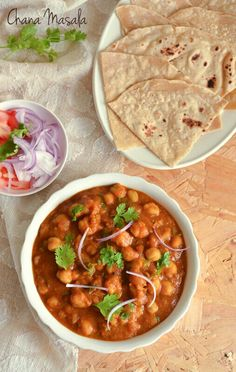 """Chole Masala with Roti Ingredients Dry chickpeas- 1/2 to 3/4 cup Kashmiri chili powder- 1 tsp(or to taste) Coriander powder- 1.5 tsp Turmeric powder- 1/2 tsp Garam masala powder- 3/4 tsp Green chili( cut vertically)- 1 no Water- 1 and 3/4 to 2 cups Chopped Coriander leaves: 2 tbsp Oil- as required Salt- to taste To grind together Diced Onion- 1 large Diced Tomato- 1 large Ginger- 1"""" piece Garlic- 2 small cloves Directions Soak chickpeas overnight (or for about 8 hrs).Drain ,rinse well and…"""