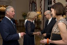 Prince Charles and Duchess Camilla of Cornwall, meet U.S. actress Elizabeth McGovern,who plays the Countess of Grantham in the television series Downton Abbey and U.S. actor Stanley Tucci, second right, during a reception for Americans living and working in the UK, at the official residence of the U.S. Ambassador to Britain, Winfield House on March 9, 2015 in London, United Kingdom. The reception was held Monday evening ahead of Prince Charles and his wife Camilla visiting the U.S. next…