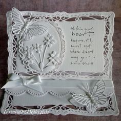 A Scrapjourney: Shaped cards all white with butterflies, flowers and ribbon.