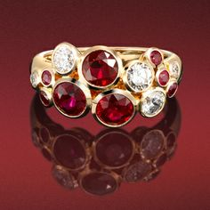 Brilliant cut diamond and ruby 'Bubble ring' in 18ct rose gold