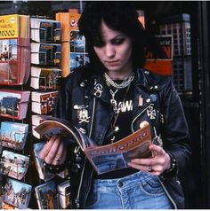 Joan jett with a magazine