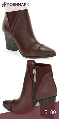 """Gorgeous Chianti Booties by Donald J. Pliner A snake-embossed cap toe and sculptural heel enhance the modern refinement of a pointy-toe bootie fashioned with a stretchy shaft to ensure a custom fit. -3.5"""" heel -4"""" shaft -Side zip closure -Leather and textile upper and lining/leather and rubber sole Donald J. Pliner Shoes Ankle Boots & Booties"""