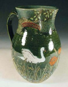 Glazed in a multitude of greens, this pitcher is cool, like a spot of shade on a summer's day.