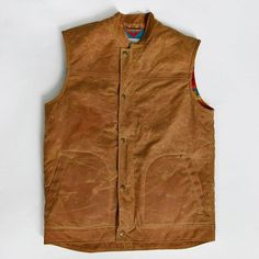 Upcoming vest pt. II • Army duck wax canvas. . •Condensed Turquoise Pendleton® wool lining. . •Deerskin interior welt pocket, hunted by Ginew. . •Novel Ojibwe-Oneida snaps. . •Added length for riding comfort. .