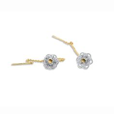 These exquisite threaded Zeeland button earrings are made in 14k yellow gold and sterling silver. The detailing is exceptional. They are a stud earring with long chain drop at back. A contemporary twist on a traditional dutch earring.