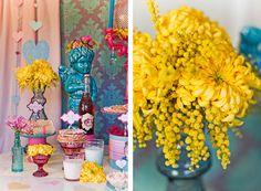 Gorgeous yellow flower arrangement of chrysanthemums and wattles.
