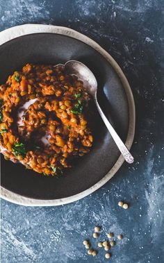 Tomato lentils, cooked in coconut milk with smoked paprika and canned crushed tomatoes. partner: @muirglen -- Cheap and delicious dinner! Bold flavors, vegan, gluten-free