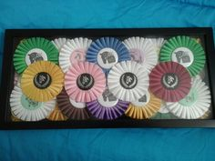 Made my own rosette shadow box from my 2014 ribbons and show coaching clinic ribbons from Johnston  County Horse Show Series. These beautiful ribbons are made by Mclaughlin Ribbon Awards!  www.mclaughlinribbonawards.com