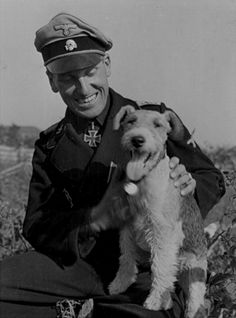 ■ The commander of the 5 SS Panzer Division Wiking,StandartenführerJohannes-Rudolf Mühlenkamp with afox terrier inKovel. September,1944