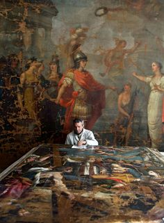 """Art restoration in Italy: a photographic reportage in L'Aquila after the earthquake  - Placing the Bedeschini's painting """"Il miracolo della vera croce"""" in a new room of the labs."""