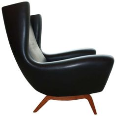 Lounge Chair by Illum Wikkelso in wonderful soft black vintage leather on black walnut frame. Model 110, produced by Soren Willadsens in Vejen, Denmark, 1960's. | From a unique collection of antique and modern armchairs at http://www.1stdibs.com/furniture/seating/armchairs/