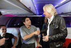 Richard Branson welcomes Joe Jonas to his flight.