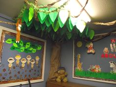 Part of the Jungle Theme Sunday School Room decorations I recently did. This is one of the trees between two of the bulletin boards. The vines are crumpled strips of brown butcher paper. I also posted the template with the instructions for the leaves. This would also work well in a classroom or for a party.