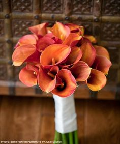 Bouquet of coral cala lillies... not as an entire bouquet but use a few in a bouquet of white lillies/other flowers.