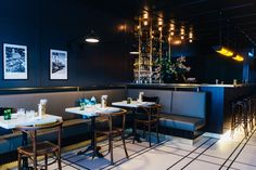 """Tim Raue's new brasserie, """"Colette"""", can be found directly opposite KaDeWe, near Berlin's busy boulevards of. Timber Slats, Timber Panelling, Bar Design Awards, Wall Cladding, Dark Wood, Coffee Shop, Interior Design, Interior Ideas, Flooring"""