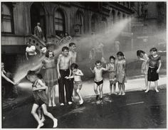 Summer on the Lower East Side <  Weegee 1937  - and the boy in the middle looks like George W. Bush  ;-)