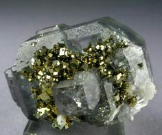 A combination of Flourite, Quartz and Pyrite.