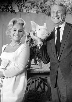 """Green Acres is the place to be.... farm livin' is the life for me...""  Lisa (Eva Gabor) and Oliver (Eddie Albert) Douglass moved from Manhattan, New York, to Hooterville."