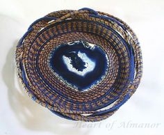Almanor Blue is a beautiful dyed agate basket made with pine needles and thread. This stone resembles Lake Almanor with it heart shape and is as blue as the lake on a frosty morning.