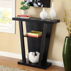 Black Finish Console Sofa Entry Table, Overstock.com, $110, Black. Dimensions: 34 inches high x 32 inches wide x 12 inches deep