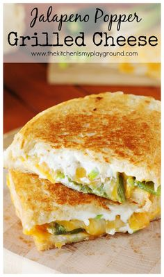 Jalapeno Popper Grilled Cheese ~ Not your average grilled cheese!  Kick up the heat and creaminess with this delicious jalapeno popper version.   www.thekitchenismyplayground.com