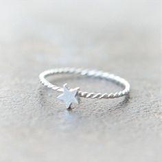 Hey, I found this really awesome Etsy listing at https://www.etsy.com/listing/108499492/tiny-star-ring-in-sterling-silver