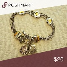Brighton heart bracelet Very pretty bracelet. Good weight. Gold and silver in color. Brighton Jewelry Bracelets