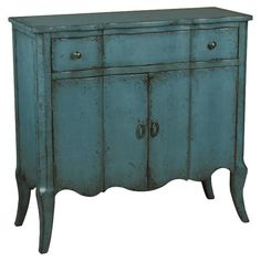 Add a rustic touch to your living room or den with this 2-door cabinet, showcasing 1 drawer and a weathered teal finish.   Product:...